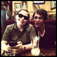 Photo taken at The Lion & Rose British Restaurant & Pub by Mary B. on 4/7/2012