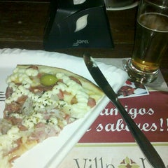 Photo taken at Villa Rios Pizza & Restô by Luciana B. on 4/1/2012