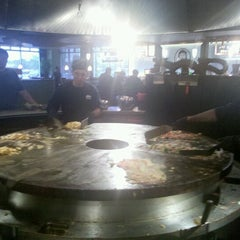 Photo taken at HuHot Mongolian Grill by Dennis P. on 8/4/2012