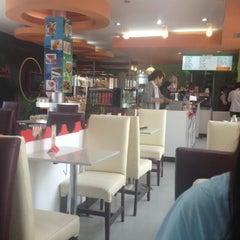 Photo taken at ระเบียงสบาย (Library Café) by D E V I L U C H I F. on 7/27/2012
