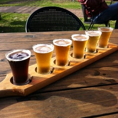 Photo taken at Bluetongue Brewery Cafe by Aurora on 6/29/2012