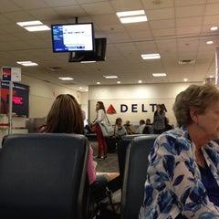 Photo taken at Gate A26 by Julie J. on 6/5/2012