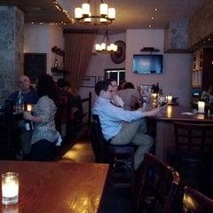 Photo taken at The Tangled Vine Wine Bar & Kitchen by Teresa K. on 6/4/2012