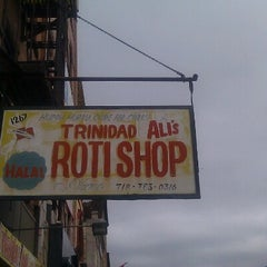 Photo taken at Ali's T & T Roti by Leah C. on 7/28/2012