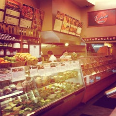 Photo taken at Tribeca Bagels by Eros V. on 4/14/2012