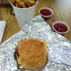 Photo taken at Five Guys by Whitney N. on 3/10/2012