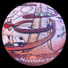 Photo taken at Nando's by Farah Fauzlyana on 3/15/2012