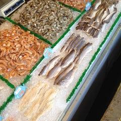 Photo taken at Maine Avenue Fish Market by Suzie R. on 3/11/2012