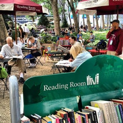 Photo taken at The Reading Room - Bryant Park by Greg L. on 6/14/2012