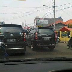 Photo taken at Jl Raya Jatiwaringin Pondok Gede Jakarta Timur by Tirta B. on 3/31/2012