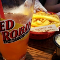 Photo taken at Red Robin Gourmet Burgers by Jennifer O. on 6/10/2012