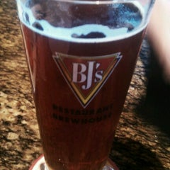 Photo taken at BJ's Restaurant and Brewhouse by CJ B. on 7/27/2012