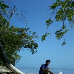 Photo taken at Pantai Ujung Genteng by Yudhi T. on 9/2/2012