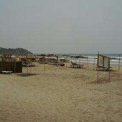 Photo taken at Morjim Beach by Anton N. on 4/11/2012