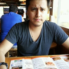 Photo taken at Hooters by Chris G. on 7/12/2012