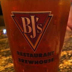 Photo taken at BJ's Restaurant and Brewhouse by Jennifer C. on 5/23/2012