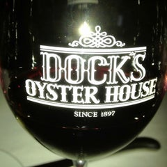 Photo taken at Dock's Oyster House by Steve A. on 6/10/2012