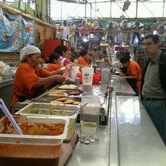 Photo taken at Mercado 24 de Agosto by Cuervo on 6/16/2012