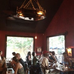 Photo taken at Justine's Brasserie by Amy K. on 8/4/2012