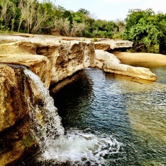 Photo taken at McKinney Falls State Park by Adreia H. on 6/17/2012