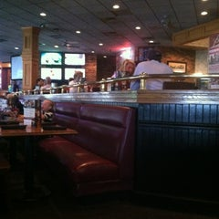 Photo taken at Champps Americana by Ana B. on 7/15/2012