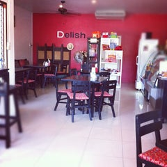 Photo taken at Delish Cafe by jingoto w. on 2/21/2012