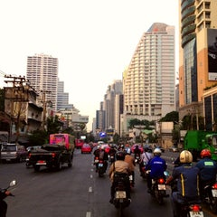 Photo taken at แยกอโศก (Asok Intersection) by Andrew V. on 3/14/2012