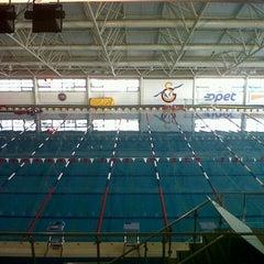 Photo taken at Galatasaray Spor Kulübü Yüzme Şubesi by Dogan A. on 9/7/2012