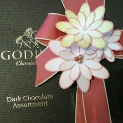 Photo taken at Godiva Chocolatier by German S. on 4/2/2012