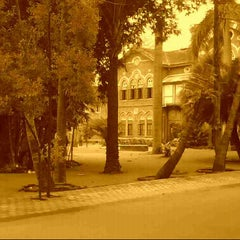 Photo taken at Fergusson College by Samata A. on 7/30/2012