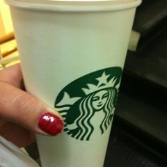 Photo taken at Starbucks by klaudita C. on 7/4/2012