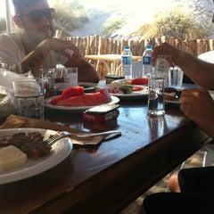 Photo taken at Ramo Beach by Burak H. on 7/7/2012