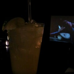 Photo taken at Skybox Bar & Grill (Above Hollywood Theater) by Gregory A. on 5/27/2012