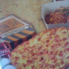 Photo taken at Yellow Cab Pizza Co. by Jm B. on 6/14/2012