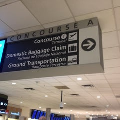 Photo taken at Concourse A by Aaron B. on 6/15/2012