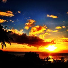 Photo taken at Waimea Bay by Kenny B. on 7/31/2012