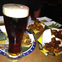 Photo taken at Buffalo Wild Wings Grill & Bar by Jesse D. on 8/16/2012