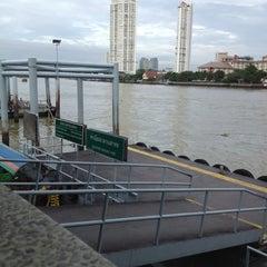 Photo taken at ท่าเรือสาทร (ตากสิน) Sathorn (Taksin) Pier CEN by Wanza Z. on 6/30/2012