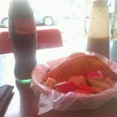 Photo taken at Tacos El Güero Transito by Alfredo J. on 6/16/2012