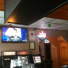 Photo taken at Sauced Sports Bar and Pizzeria by Chris S. on 3/21/2012