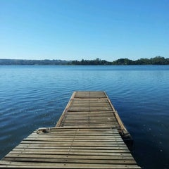 Photo taken at Lago Paranoá by Andre B. on 3/4/2012