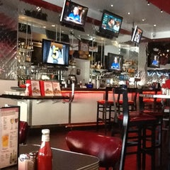 Photo taken at Johnny Rockets by Ali S. on 3/20/2012