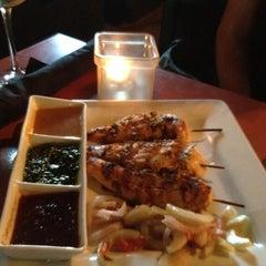 Photo taken at Rumba Rum Bar & Satay Grill by Ingrid H. on 6/27/2012
