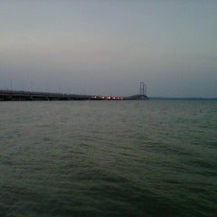 Photo taken at Jembatan Suramadu (Suramadu Bridge) by Ezhie S. on 8/23/2012