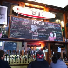 Photo taken at Rogue Ales Public House & Distillery by emuchico W. on 4/26/2012