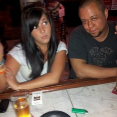 Photo taken at Uncle Joe's Bar & Grill by Amber W. on 5/9/2012
