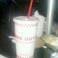 Photo taken at Five Guys by Danny E. on 3/15/2012