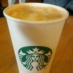 Photo taken at Starbucks by S L. on 3/15/2012