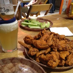Photo taken at Hooters by Sheldon W. on 7/8/2012