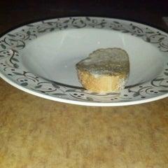 Photo taken at Ezio's Italian Restaurant by Katie S. on 7/7/2012